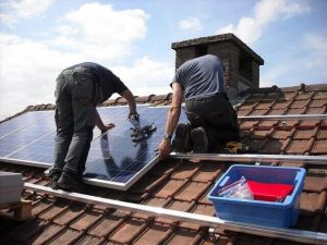 Installation of solar panels on a rooftop UK
